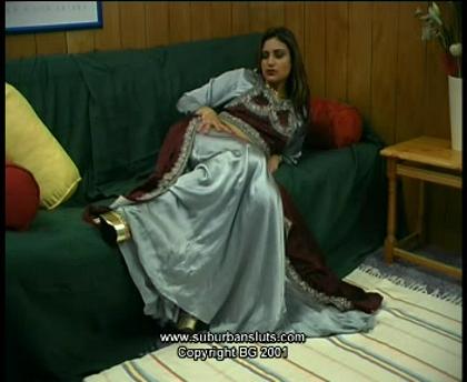 Malvina dressed in traditional Indian sari slowly strips and masturbates on the sofa